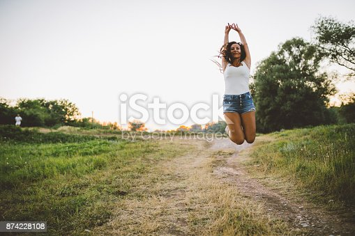 516318379 istock photo Young woman enjoying a sunny day in the nature 874228108