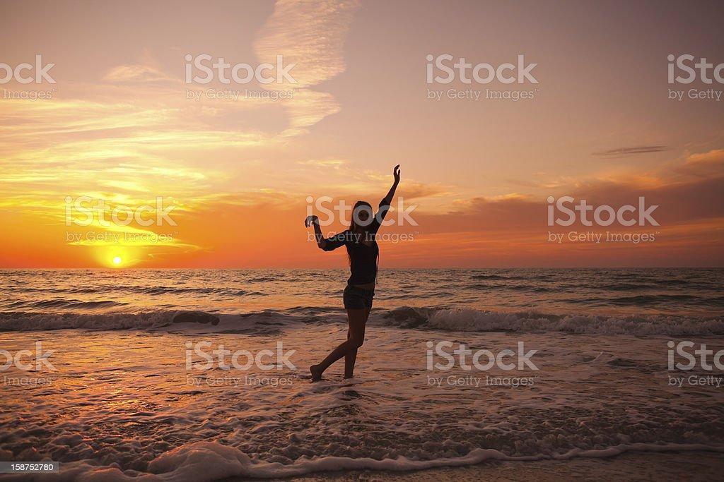 Young woman enjoying a sunset royalty-free stock photo
