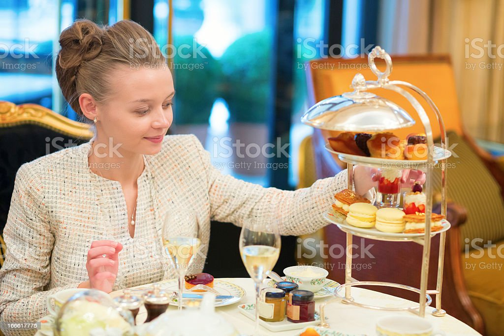 A young woman enjoying afternoon tea stock photo