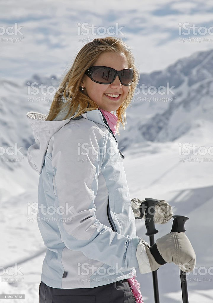 Young Woman Enjoying Alpine Skiing royalty-free stock photo