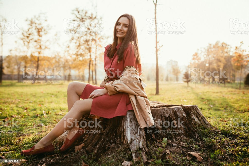 Young woman enjoying an autumn day in the public park stock photo