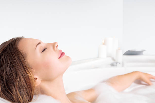 Young woman enjoying bathing in bathtub Young beautiful woman enjoying bathing in bathtub bathtub stock pictures, royalty-free photos & images