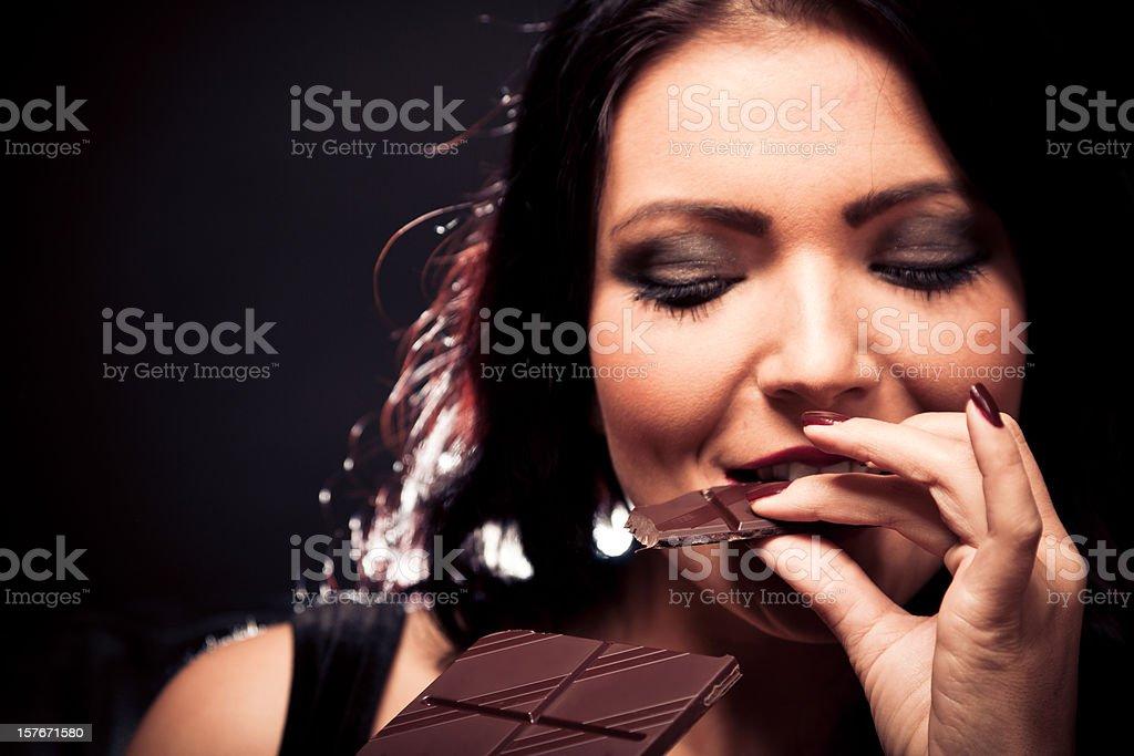 young woman enjoying chocolate royalty-free stock photo