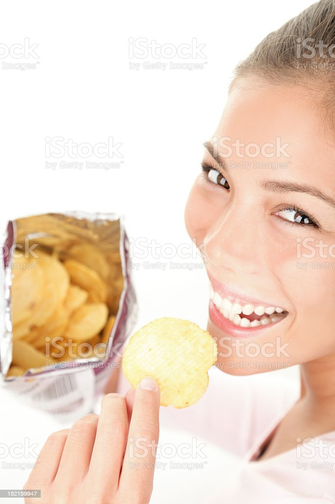 Young woman enjoying eating a bag of chips royalty-free stock photo