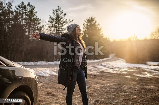 Young woman enjoying freedom in nature