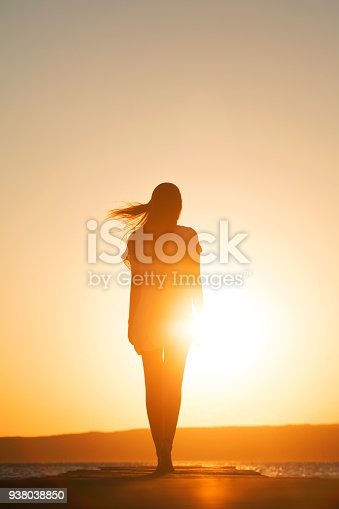 Young woman enjoying freedom in summer