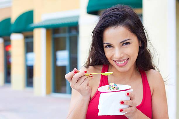 Young Woman Enjoying Frozen Yogurt stock photo