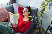 Young Woman enjoying her book after a long time later