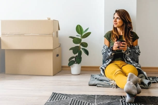 Young woman enjoying her new apartment stock photo