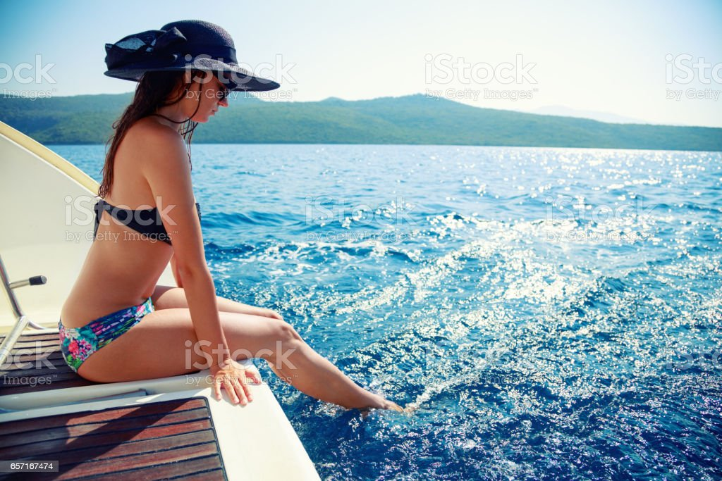 Young woman enjoying her vacation on sailboat stock photo