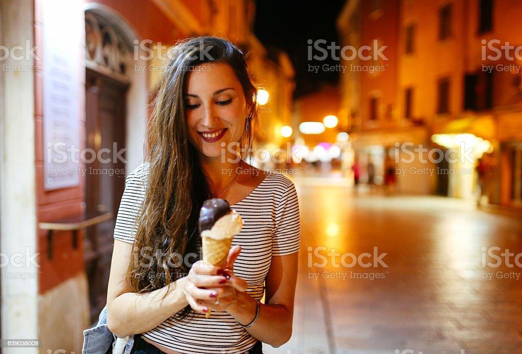 Young woman enjoying ice cream on the streets of Rovinj stock photo