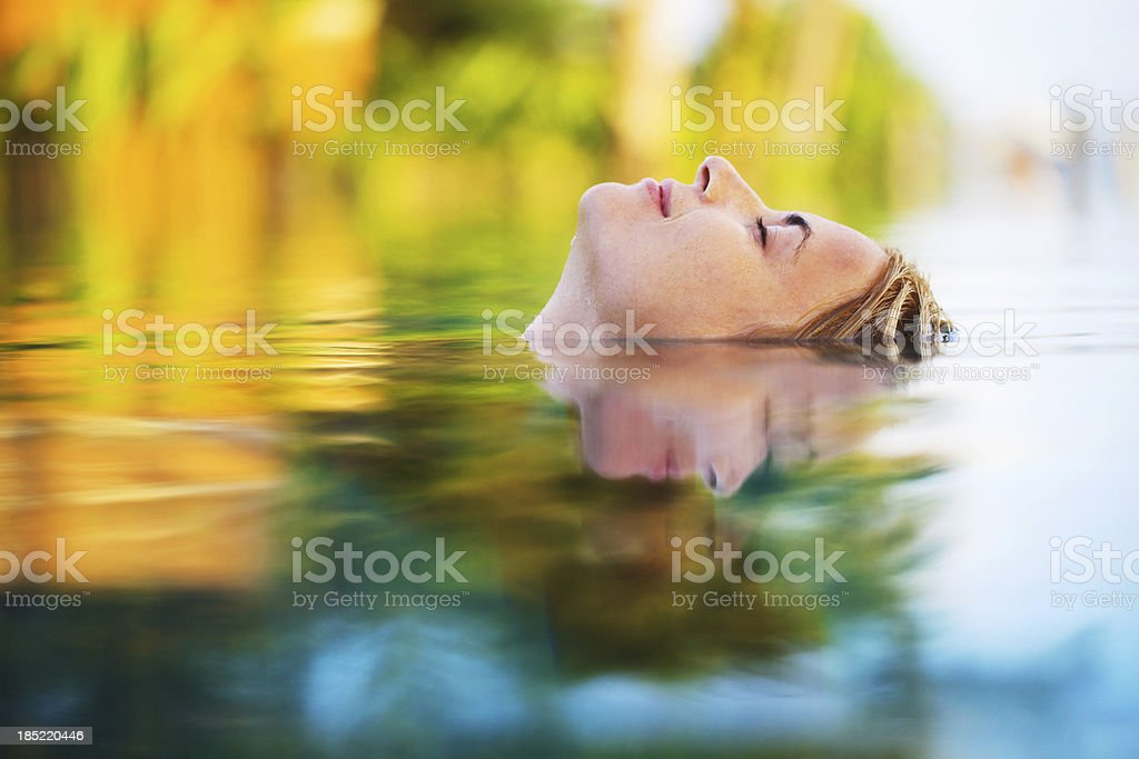 Young woman enjoying in the water. royalty-free stock photo