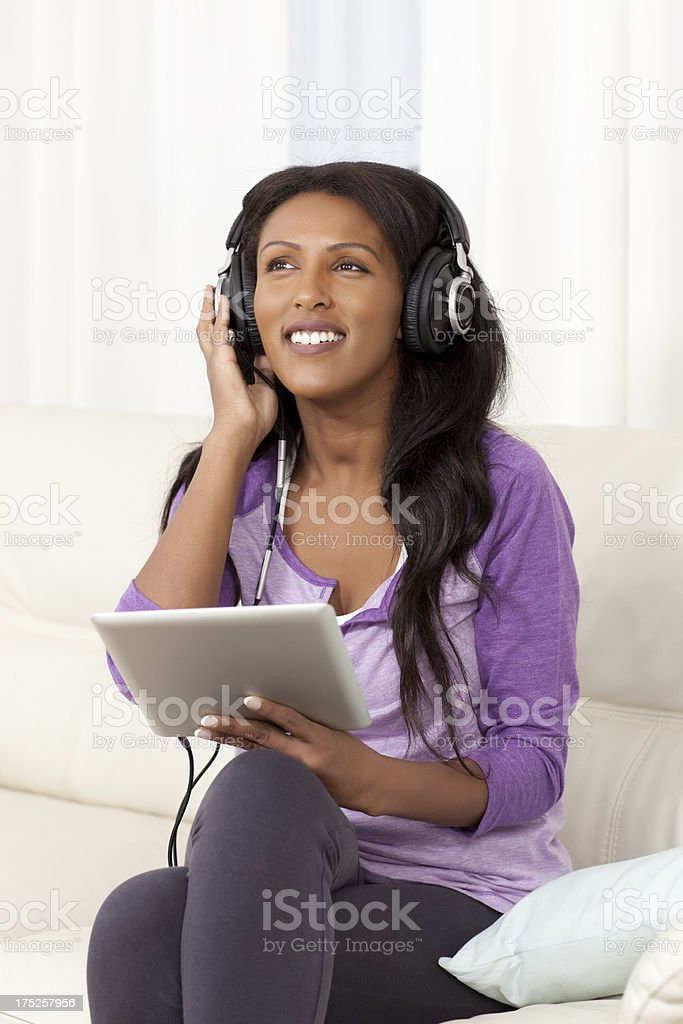 Young woman enjoying music on digital tablet. royalty-free stock photo