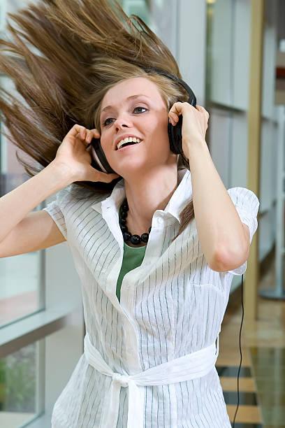 Young Woman Enjoying Music stock photo