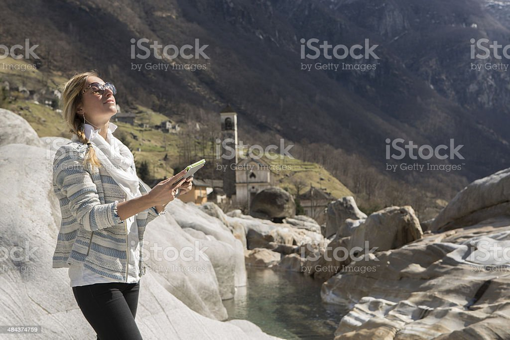 Young woman enjoying nature and digital tablet royalty-free stock photo