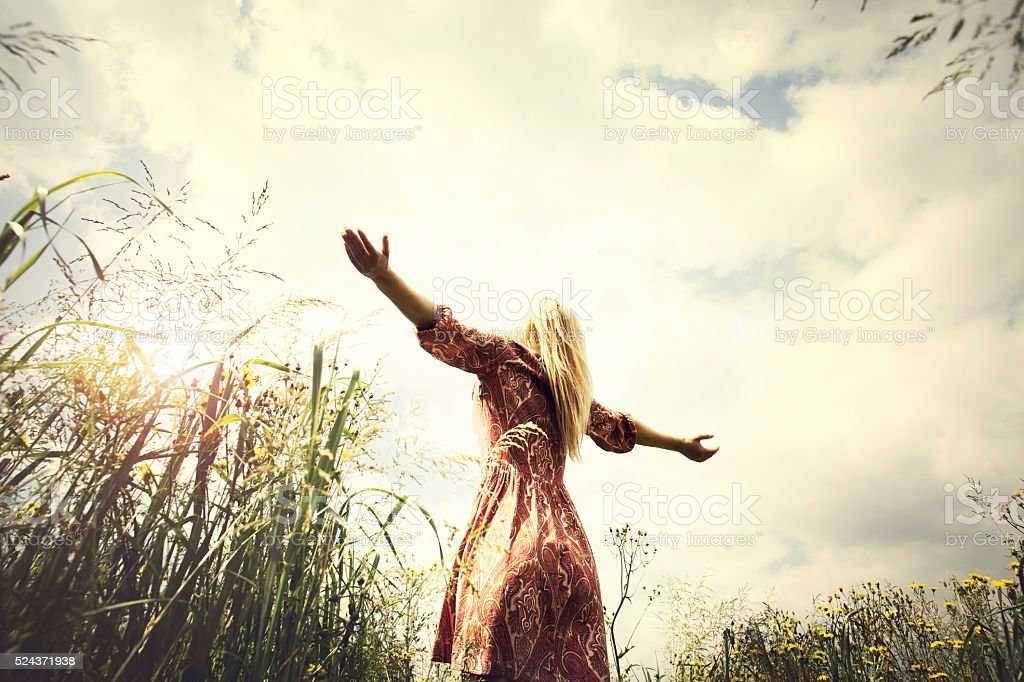 young woman enjoying nature in the middle of a meadow stock photo