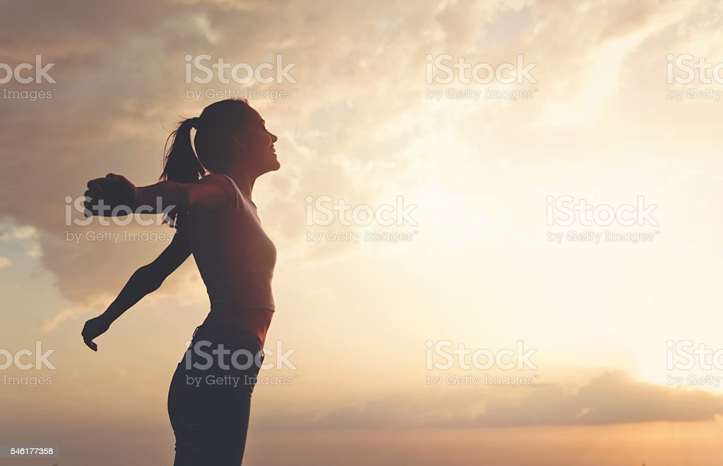 Young woman enjoying outdoors, sky background stock photo