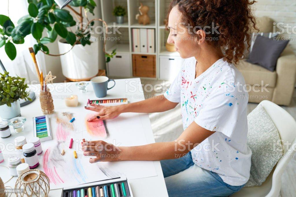 Young Woman Enjoying Painting stock photo
