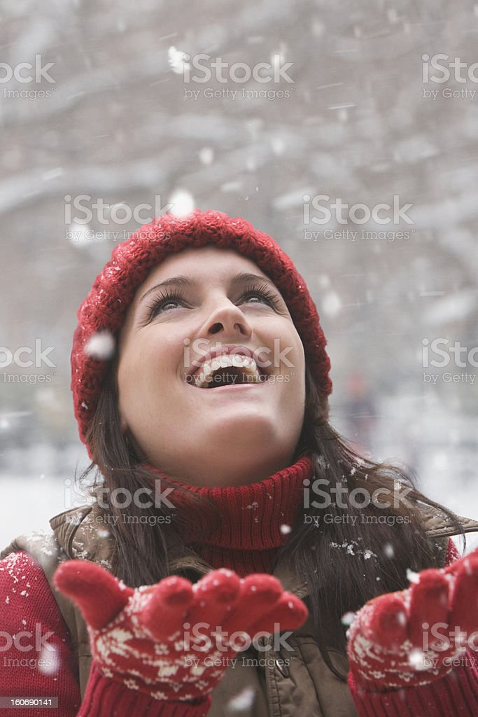 Young woman enjoying snow falling royalty-free stock photo