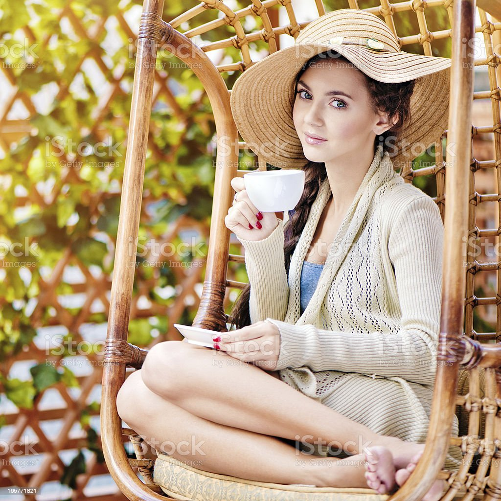 Young woman enjoying tea royalty-free stock photo