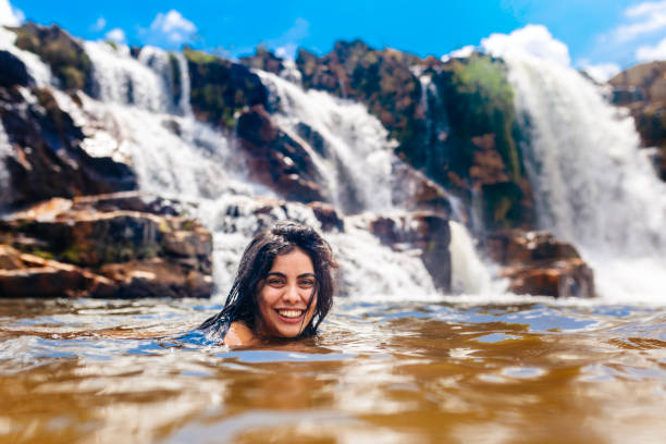 Young woman enjoying the Cascata dos Couros, Chapada dos Veadeiros Young woman enjoying the Cascata dos Couros, Chapada dos Veadeiros goias stock pictures, royalty-free photos & images