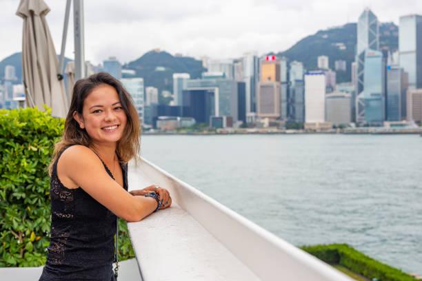 Young Woman Enjoying the Hong Kong Skyline View stock photo
