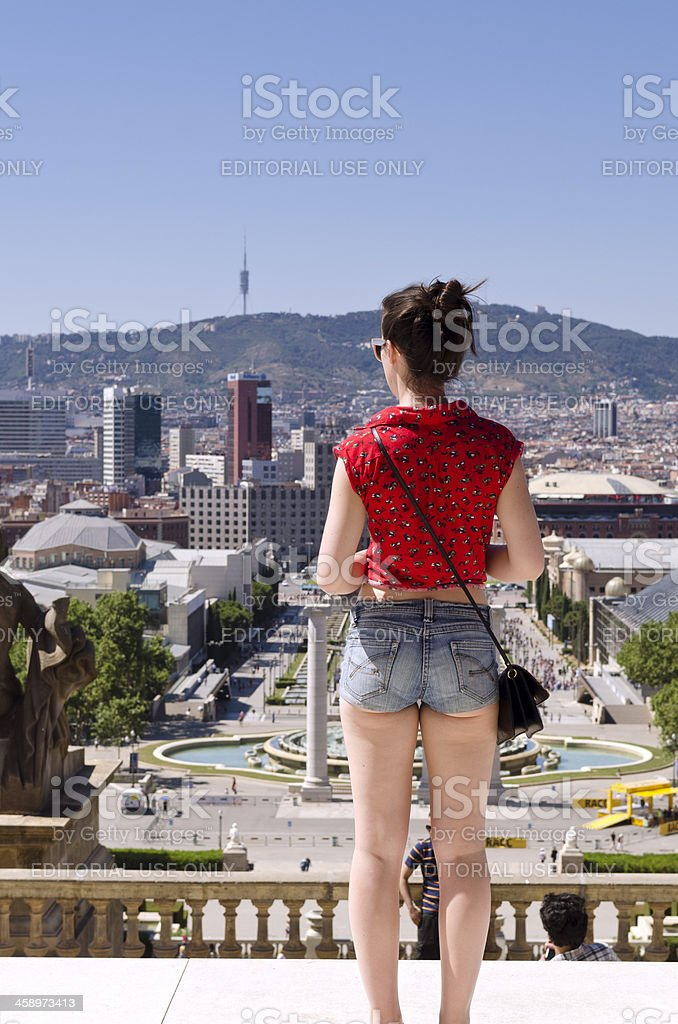 Young woman enjoying the spectacular views of Barcelona from Montjuic. stock photo