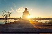 Young woman enjoying the sunset - Hungary - Bokod.