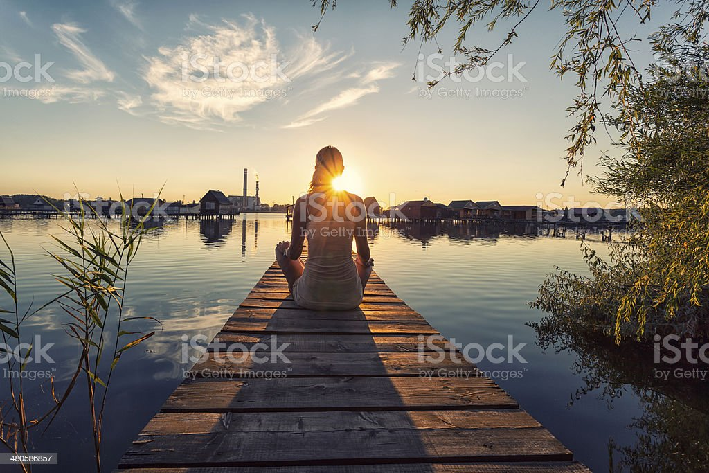 Young woman enjoying the sunset stock photo