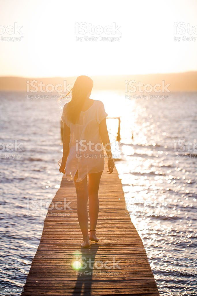 Young woman enjoying the sunset royalty-free stock photo