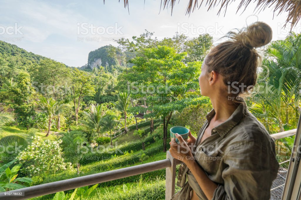 Young woman enjoying the view from tree house, Thailand stock photo