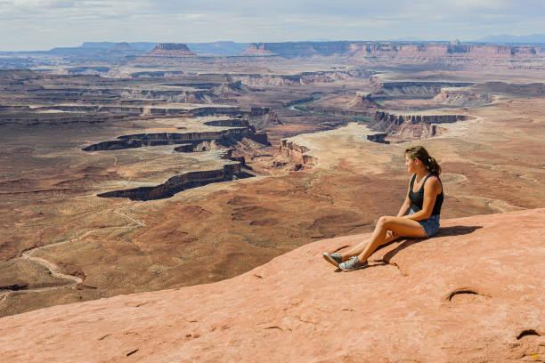 Young Woman Enjoying View of Grand Canyon, Arizona, USA stock photo