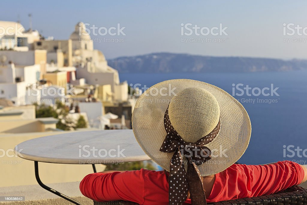 young woman enjoying view of Santorini, Greece royalty-free stock photo