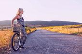 istock Young woman enjoying with her bike 840919764