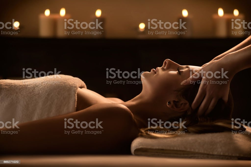 Young woman enjoys massage in a luxury spa resort stock photo