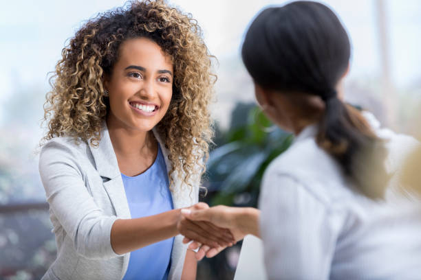 Young woman enjoys meeting new therapist stock photo