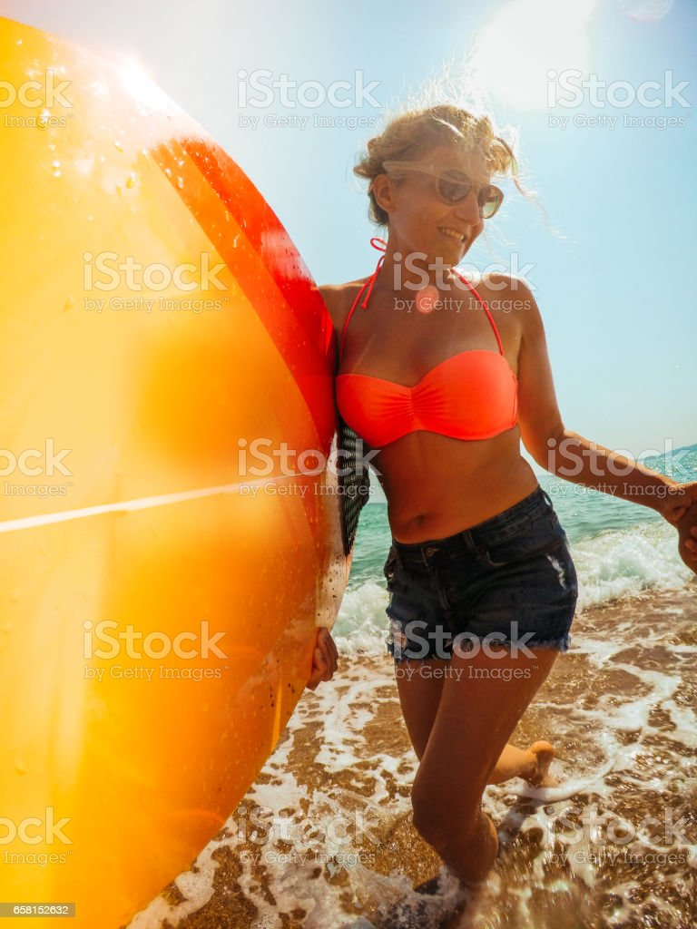 Young woman enjoys summer sports stock photo