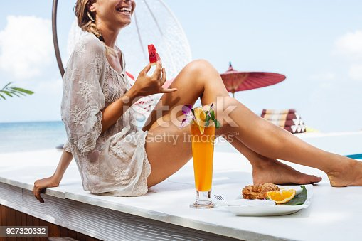 538041934 istock photo Young woman enjoys vacation 927320332