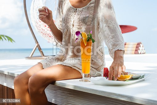 538041934 istock photo Young woman enjoys vacation 927320364