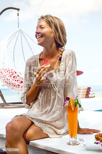538041934 istock photo Young woman enjoys vacation 927320392