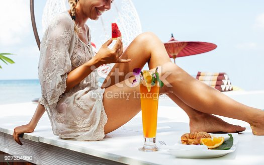 538041934 istock photo Young woman enjoys vacation 927354950
