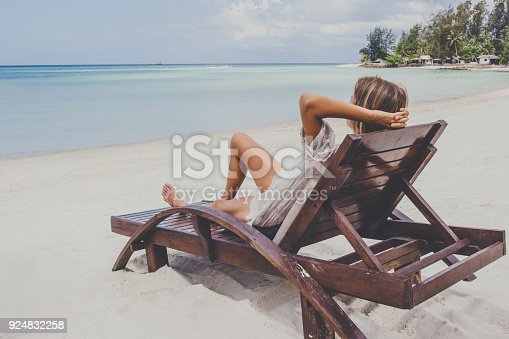 538041934 istock photo Young woman enjoys vacations 924832258
