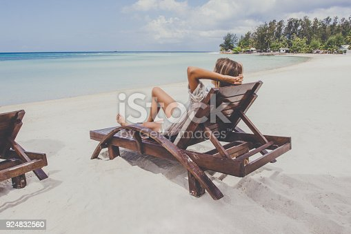 538041934 istock photo Young woman enjoys vacations 924832560