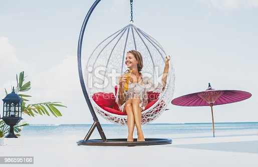 538041934 istock photo Young woman enjoys vacations 986595166