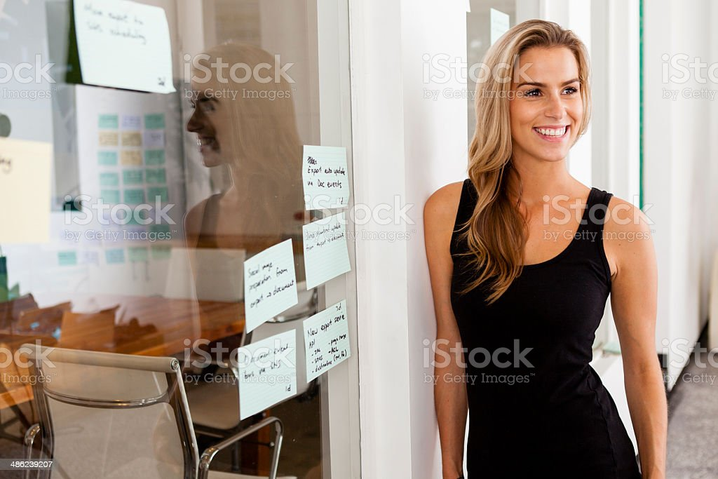 Young woman entrepreneur in her startup office stock photo