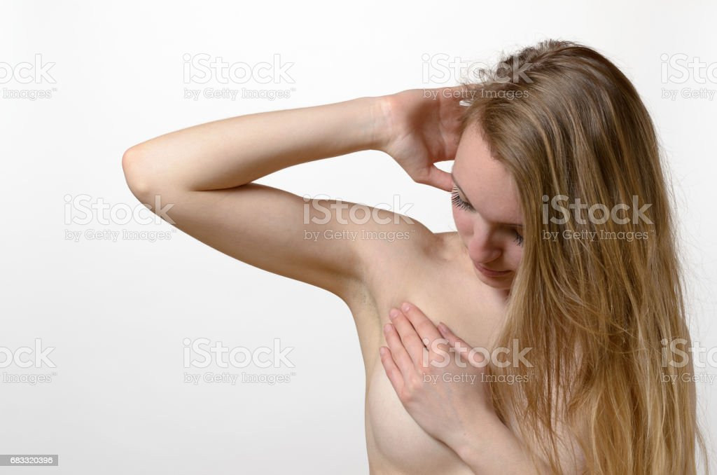 Young woman examining her breast for lumps foto stock royalty-free