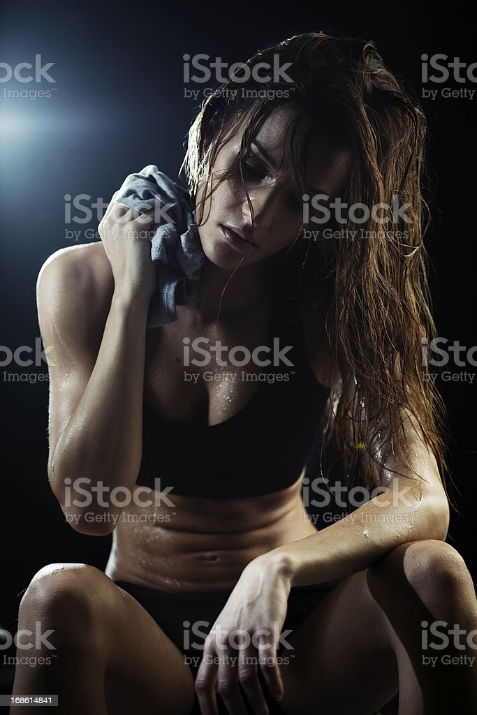 Young woman exercicing in the gym. stock photo