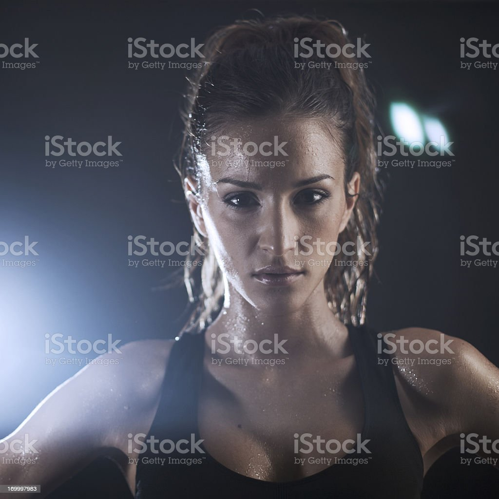 Young woman exercicing in the gym royalty-free stock photo