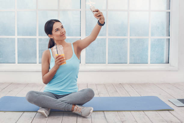 Young woman exercise at home healthy lifestyle stock photo