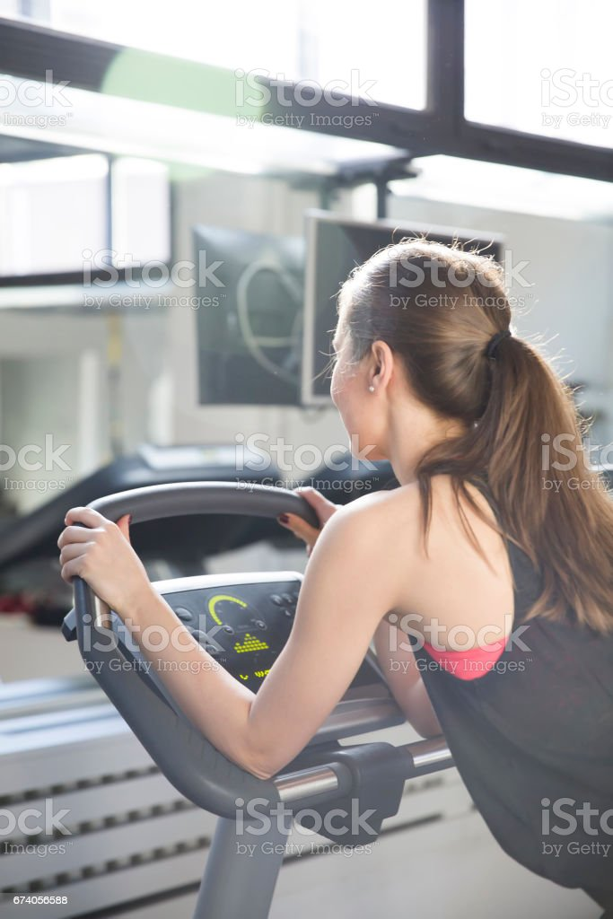 Young woman exercise on the treadmill at the gym royalty-free stock photo